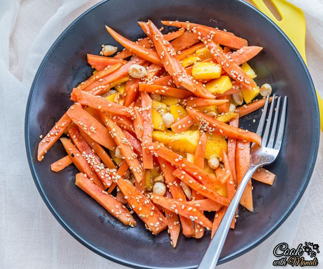 Mango and papaya slices tossed in lemon-soya sauce dressing and topped ...