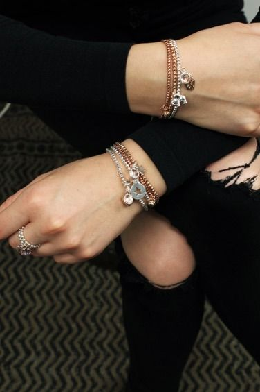Gold and silver beaded charm bracelets and a silver ring with pink gem by  Peace of Mind