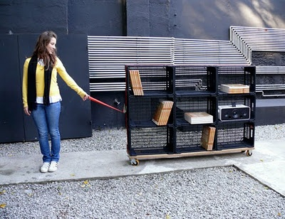 Mobile Bookshelf: This portable bookshelf on wheels is constructed from used fruit boxes.