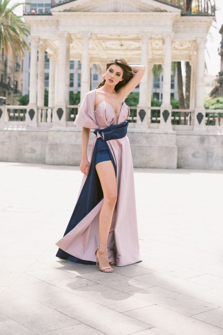 Next  Be a queen in our Gloria dress. Draping V plunge corset detail and one shoulder cover up, high split skirt, maxi dress. Julia Toaders evening dress
