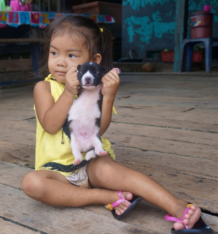 Cute little girl with a tiny puppy at the fishing village by Ao Yai, Koh Kood. See more here: http://www.kathrinerostrup.dk/2013/05/exploring-koh-kood-part-ii/