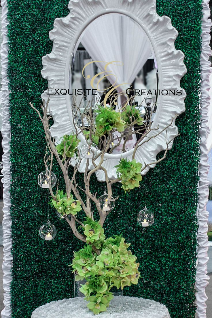 Tree branch centerpiece with flowers and hanging glass bubbles