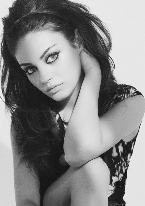 Mila Kunis.  This young woman is absolutely gorgeous.  Everytime I see her, I see my daughter in the future...their features are so similar.