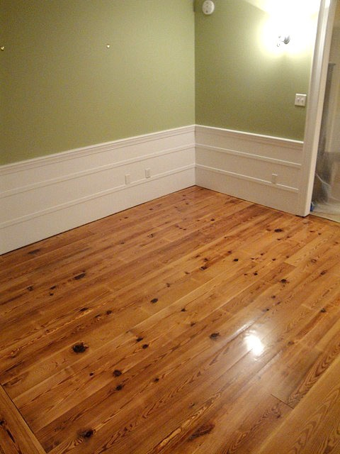 Installing the Antique Heart Pine Flooring. I also like the height of the baseboards very unique and classy!
