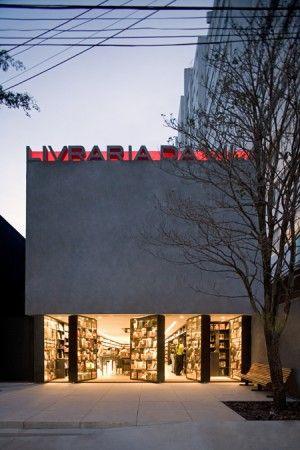 Libraria da Vila bookstore in Sao Paulo animated bottom and lighting on top?wall facade....