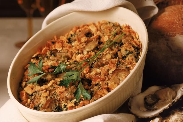 This cornbread oyster dressing is made moist and flavorful with oysters and their liquids. The cornbread and oyster dressing is baked in the oven.