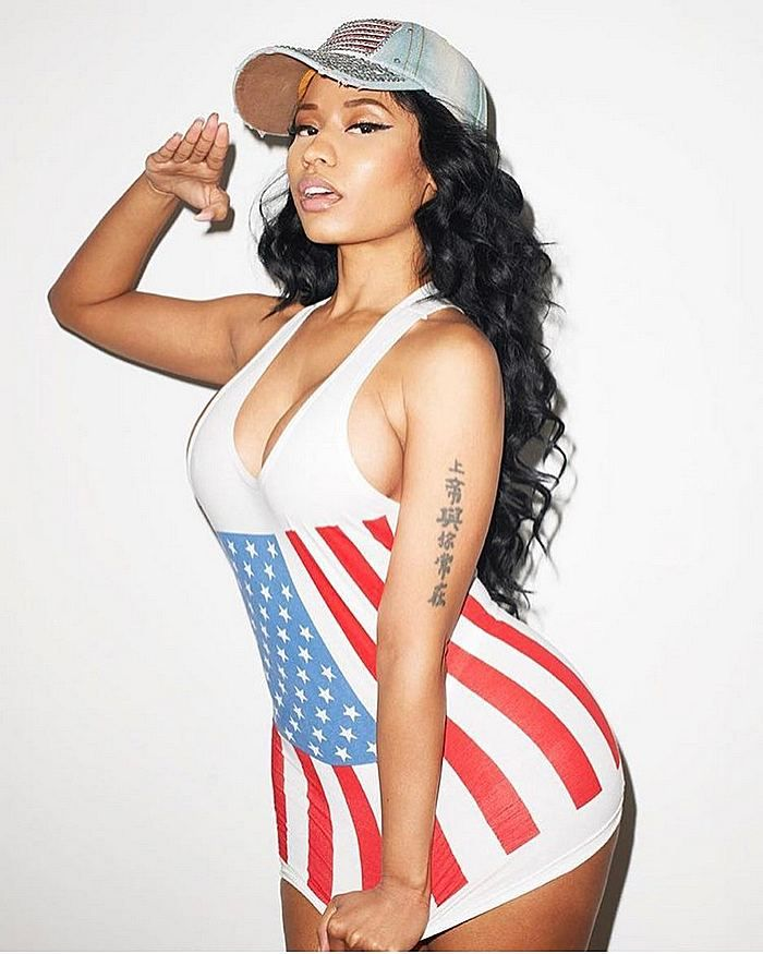 Rapper Nicki Minaj rocked a red white and blue tank top for the 4th.  http://celebsip.com/celebrity-instagram-roundup-26/