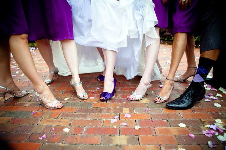 Photo by: RH Photo Arts. My bridesmaids and bridesman, showing off the most important accessory. (Love that my bridesman chose purple socks!)