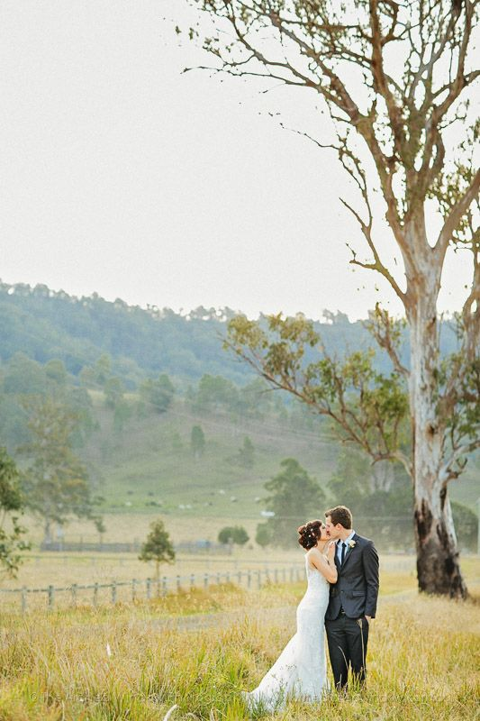 The happy couple stealing a moment together #VineyardWedding