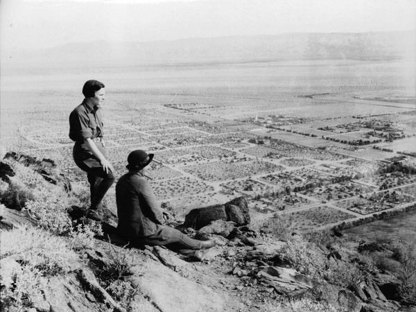 Two women look out over a rural San Fernando Valley from the Mulholland Highway, circa 1930. Courtesy of the Los Angeles Area Chamber of Com...