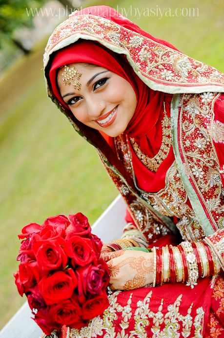 http://beautifulindianbrides.tumblr.com/post/28861815303  Lovely red wedding dress with rich gold embroidery. The bride is also wearing a red satin scarf and jewelry