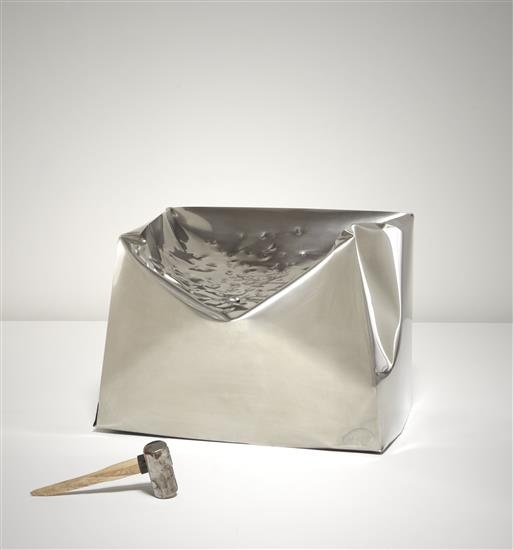 """MARIJN VAN DER POLL """"Do Hit"""" chair, ca. 2000  Stainless steel, sledgehammer. Chair: 30 x 40 x 35 1/2 in. (76.2 x 101.6 x 90.2 cm.) One of ten chairs commissioned by Droog, The Netherlands. Laser-engraved and impressed to side of chair with """"do hit by marijn van der poll for droog no. 48."""