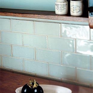 These handmade tiles from Fired Earth in a subtle opal finish sit well in most kitchen schemes