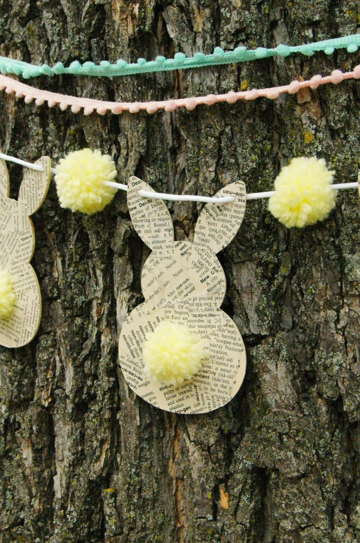 Make your own DIY Book Page Bunny Bunting! Its adorable and perfect for your Easter mantel! (ad)