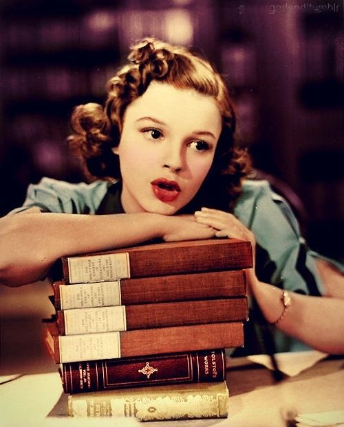 Judy Garland singing on a pile of books as she closes up the library for the night. 'Strike Up the Band' (1940)