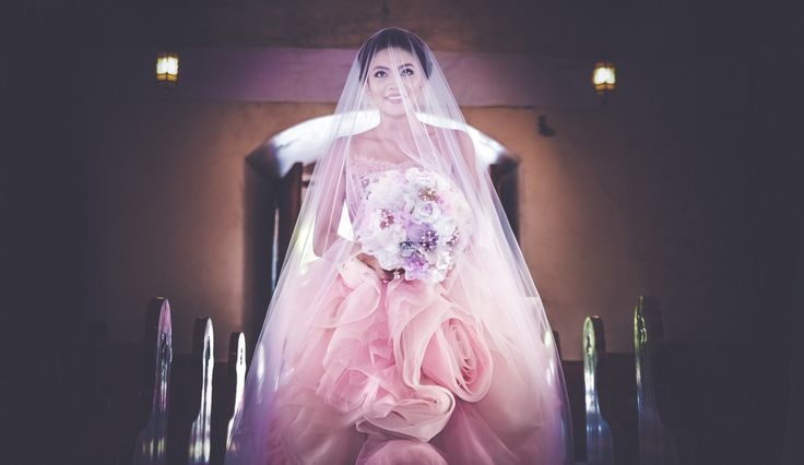 Lovely bride wearing her own creation at Malate Church, Manila, Philippines  #MRCBride #maureensweddinggowns #bridal #brides #weddinggowns #gowns