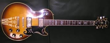 This Ibanez Les Paul Custom, this guitar is more than a very good copy of a Gibson (from the LAWSUIT ERA), it's a real homage to the brand, combining the body of the LP with the headstock of their mandolin models.  Add to that the mother-of-pearl inlays, and you have a remarkable, beautifully classic and slightly bizarre instrument!