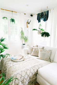 25 Bohemian Bedroom Decor Ideas That Will Make You Want to Redecorate ASAP | All white with pops of greenery | /stylecaster/