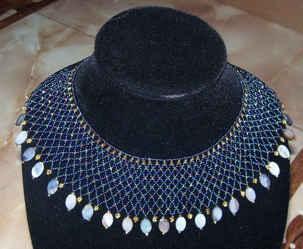 Variegated blues and gold beaded collar necklace with an oval cut shell border.    www.facebook.com/teristreasures