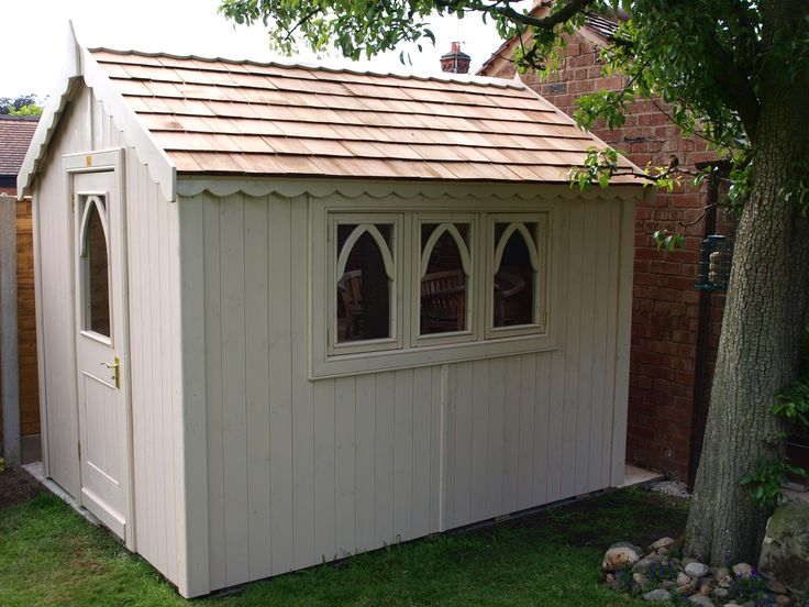 Gothic shed with cedar shingle roof and triple window for Cedar shingle shed