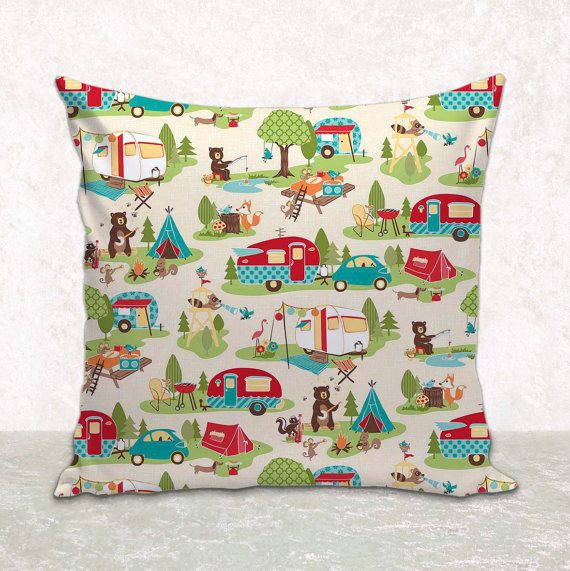 Handmade and handcrafted pillow cover featuring a designer fabric of travel trailers and camping scenery on a cream background. This item can decorate your home or RV; on a bed, sofa, chair, baby's room or kitchen seating.