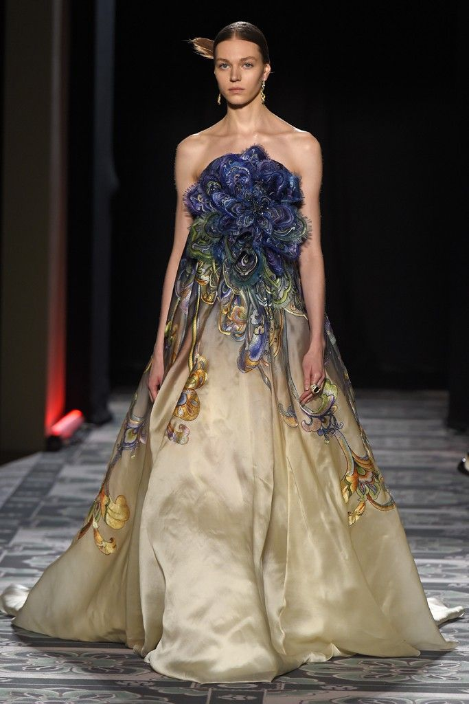 Laurence Xu Couture. This looks like an art nouveau ceramic vase.