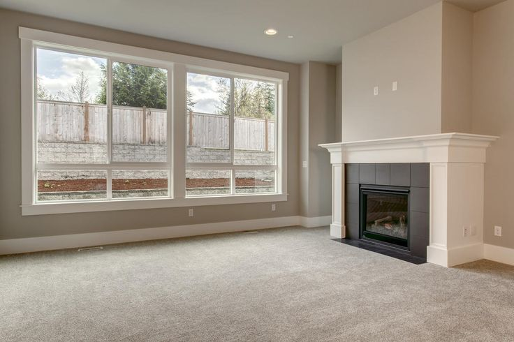 An open living room with great natural lighting and access to the fireplace