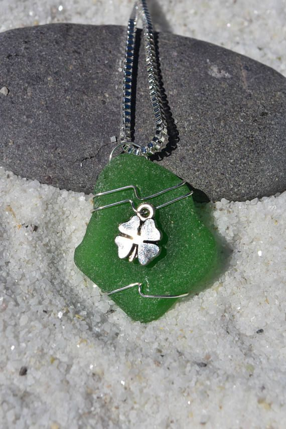 The genuine surf tumbled sea glass necklace is hand wire-wrapped with silver artistic wire and has a silver shamrock charm. Each sea glass necklace is made to order. The necklaces have fantastic shapes, and coloring. Each sea glass necklace is unique, and hand made in the USA. The necklace comes from a smoke free environment. The sea glass is genuine and was collected on the rocky shores and sandy beaches of coastal Maine. The sea glass has a lovely natural frosted surface as a result of…