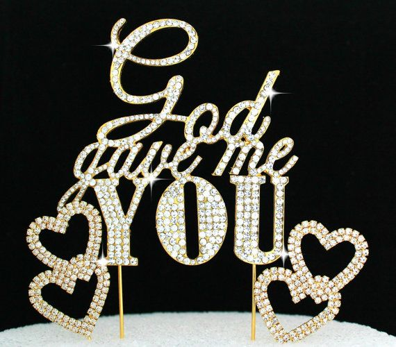 This elegant Rhinestone God Gave Me you wedding cake topper is perfection for adding that extra dazzle to your gorgeous cake! Perfect as a wedding cake topper, Anniversary Cake topper or engagement Cake topper  This is a THREE piece set. Includes two heart cake picks and God Gave Me you topper SILVER TONE ONLY AVAILABLE AT HIS TIME **ALSO AVAILABLE WITHOUT THE HEARTS AS A SINGLE TOPPER***  An absolutely stunning topper covered in crystal rhinestones. Measures 4.5 wide and 5 Tall. Metal…