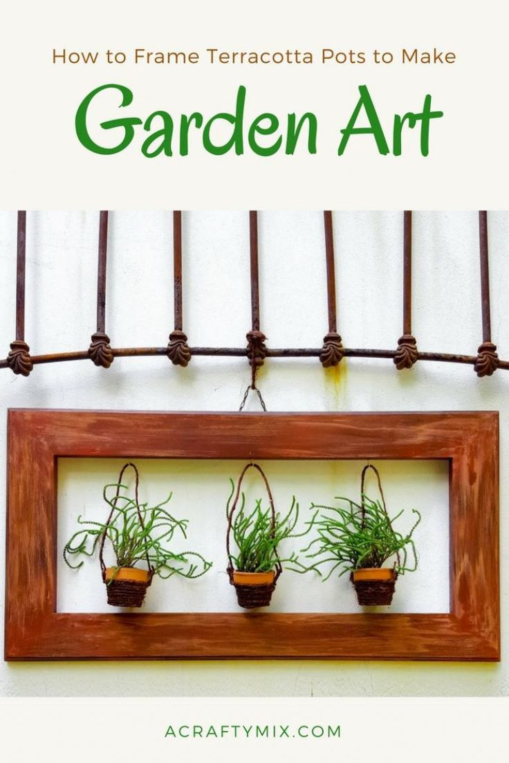 I love the way these terracotta pots have been framed. Such a lovely idea to add some art to the garden