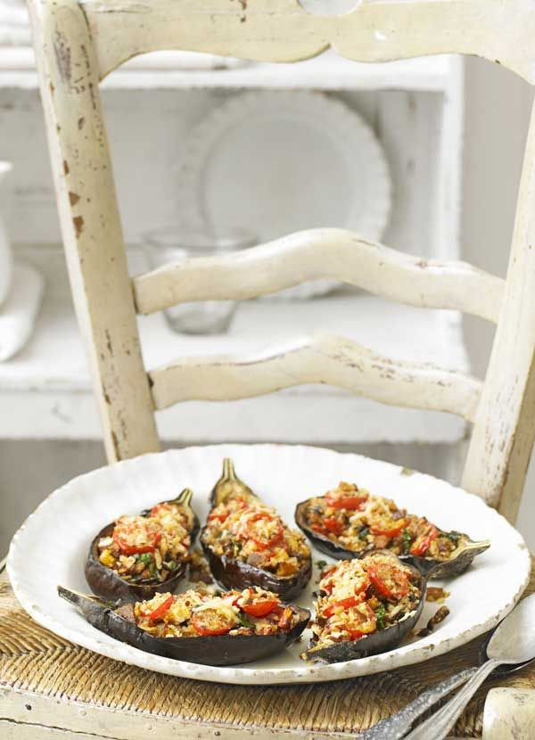 Gennaro's Contaldo's baked stuffed aubergines: Growing up, aubergines were plentiful in summer in Italy, and a very popular vegetable in the south. We would slice them and simply grill or bake them, or we'd make the famous melanzane alla parmigiana – sliced and baked in a tomato sauce with mozzarella and parmesan. A nice way with them is to stuff and bake them, as in this recipe. It is delicious served with a salad for lunch or supper