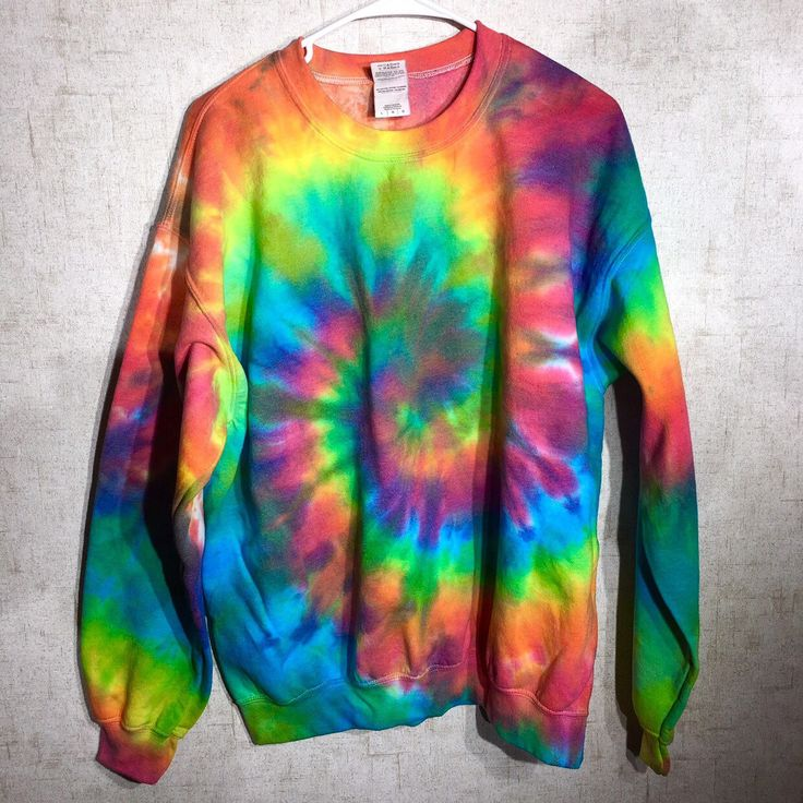 One of a kind tie dye sweatshirts, zip ups and pullover hoodies are newly stocked for the season! At Beach Bum Boutique on Etsy https://www.etsy.com/listing/487917929/tie-dye-sweatshirt-neon-rainbow-tie-dye
