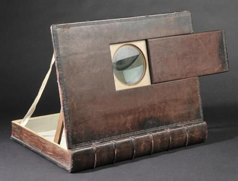 * Photographic Book Furniture. A leather-bound epidiascope or opaque projector, early 20th c.(?