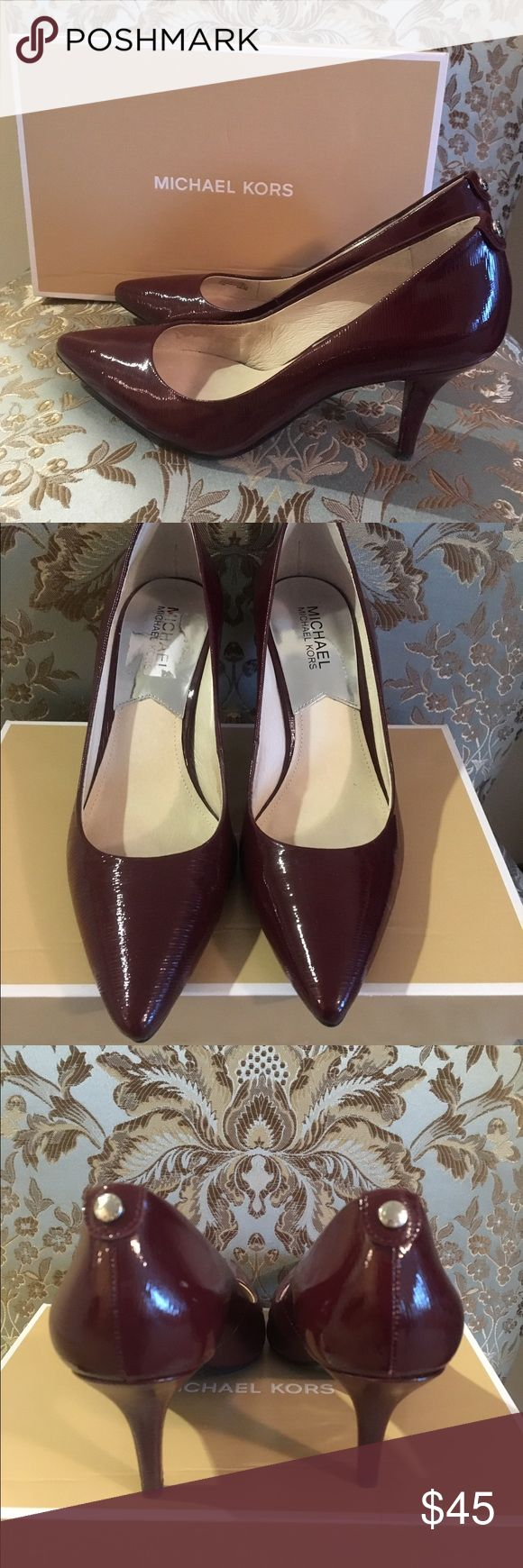 """Michael Kors 2.5"""" patent leather burgundy heels PRICED TO SELL! Gorgeous patent leather heels! Color is Merlot. Silver snap on the back that says Michael Kors. They have only been worn a couple of times. Look new. The only things are a very tiny spot on the back right heel where stitching is (in pic) and a very tiny spot on toe of the left shoe (in pic). I have odd shaped feet so they rub the top of the side of my feet near my toes. I put some cushion to try to help. There is a little…"""