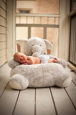 you could get this elephant plush that acts as a chair. How cute is that? | via chic.home.baby