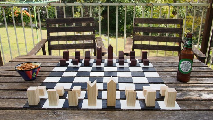 Chess board painted on table.