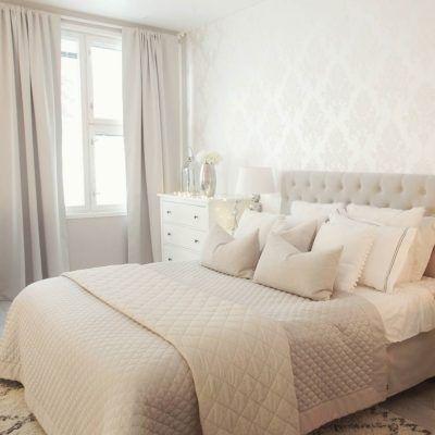Viimeistele makuuhuoneen tyyli tyynyillä ja tekstiileillä