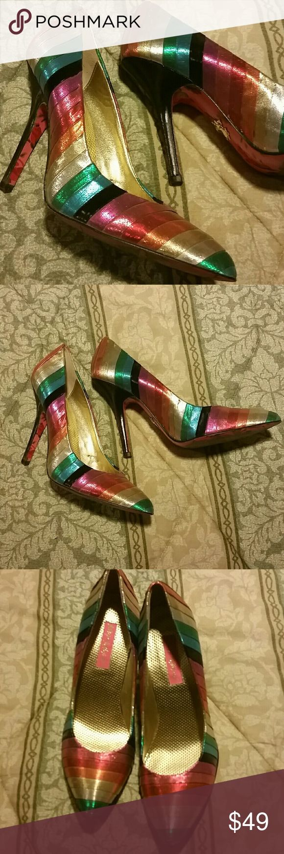 RAINBOW SPARKLE BETSEY JOHNSON PUMPS 8 Beautiful rainbow pumps by Betsey Johnson. Rainbow foil tinsel like material sparkles. Bottoms have rose design.  I had non-slip pads on the bottoms, but took them off. These were worn twice and purchased at an actual BJ store. They cost close to $250.  I love them, but they're not todder friendly :( Betsey Johnson Shoes Heels