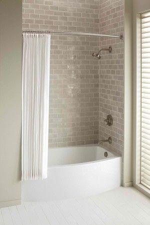 SHNS photo courtesy Kohler A curved apron bath is about four inches wider in the center of the tub than a standard bath, but then gently cur...