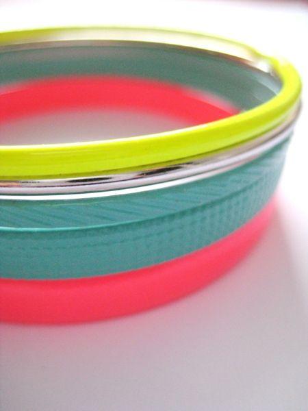 Neon bracelets.. Screams summer.  Wear with white?