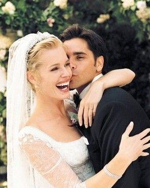 Rebecca Romijn & John Stamos on their wedding day, September 1998.