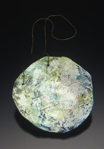 Jennifer Hall: Pendant in copper, paper, paint, colored pencil, silk and sterling silver.