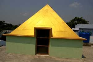 Pyramid Meditation Center.year of construction : 2009 size : 9ft x 9ft (roof top) | capacity : 30 persons cost incurred :  40,000 | type of structure : RCC timing : 24x7, open for public use technical support : Srinivas Rao contact : Ramadevi address : Vetapalem http://www.pyramidseverywhere.org/pyramids-directory/pyramids-in-andhra-pradesh/coastal-andhra/prakasam-district