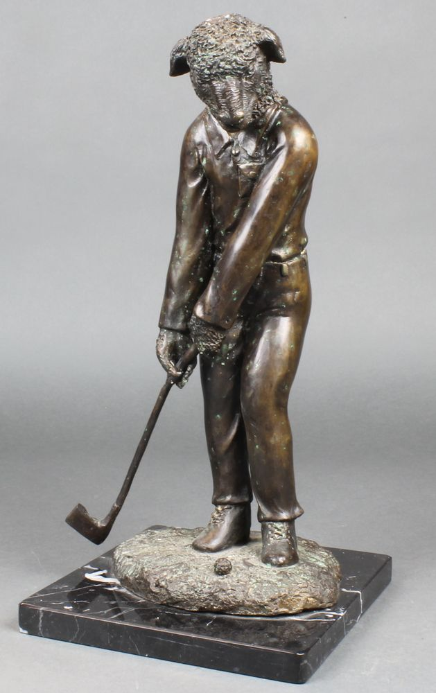 """Lot 154, A bronze figure of  a standing golfing sheep, raised on a black marble base 16""""h, est £80-120"""