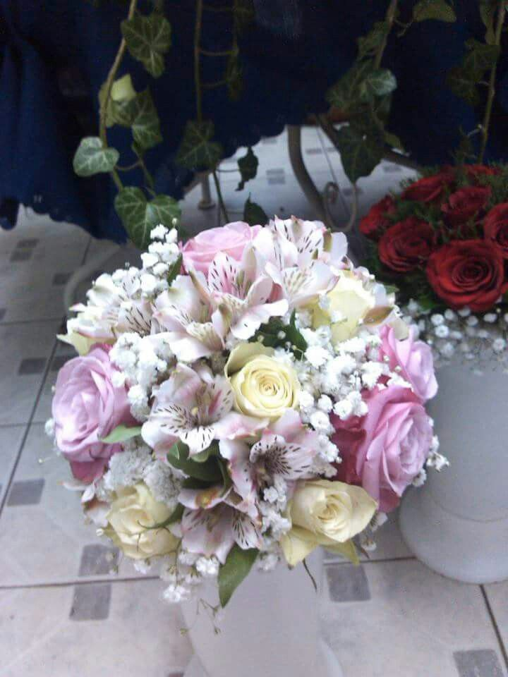 Alstroemeria, pink roses and white roses