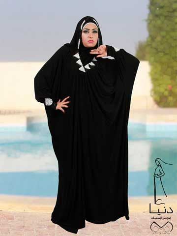 """Sohayla Fashion Abaya Butterfly style fashion abaya hand beaded around neck and cuff.  Hijab (scarf) included size 65cm x 175 cm / 25.6"""" x 68.9"""" Fabric: Lycra Washing Instructions: Machine Wash Tailored and designed by """" Donia Abayas by Donia hand beaded, never two abayas are exactly identical"""