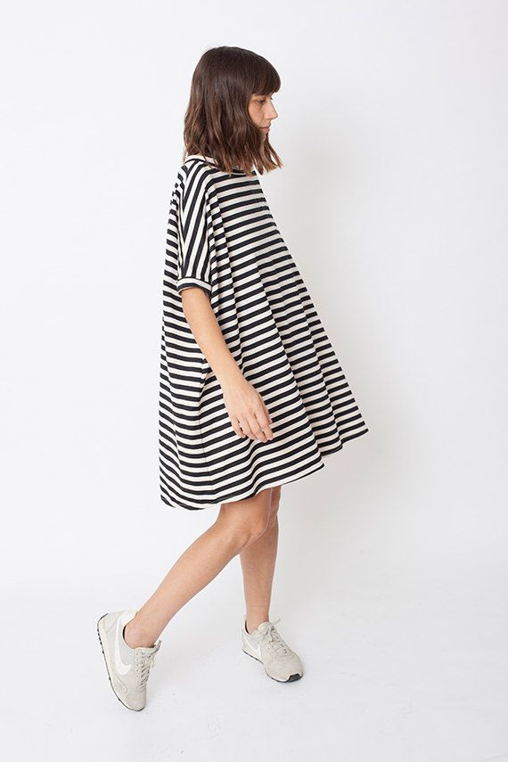 Stripped, casual, urban and easy to wear dress. Perfect for any daytime occasion-flattering and chic-in the office, or on an afternoon date. Can be