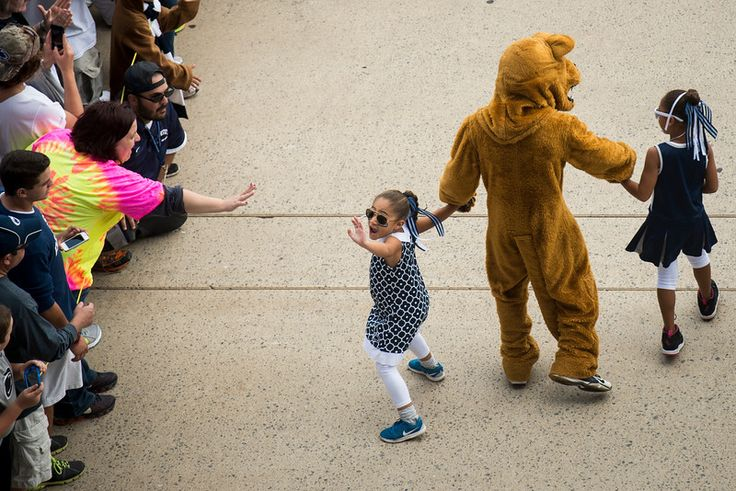 Addy and Shola, daughters of Penn State head coach James Franklin, walk with the Nittany Lion mascot before the team arrived at Beaver Stadium in State College, Pa., on Saturday, Sept. 20, 2014. Jeff Lautenberger — For The York Daily Record/Sunday News