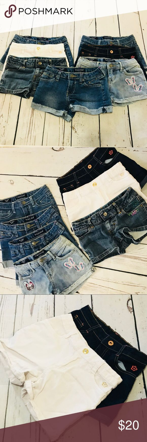 """Girls size 6 Jean Short lot of 7 Shorts Girls Jean Short lot of 7 Shorts All are a size 6 except one pair of Faded Glory that are labeled size 5 but fit like the size 6's  You get   4 pairs of Vigoss """"The Jagger Shorts"""" all size 6 with waist adjusters  55% Ramie 24% cotton 20% polyester 1% spandex  2 pairs of Limited Too Shorts Size 6X no waist adjusters inside they are the darkest blue and white pair in the photos.   98% cotton 2% spandex   1 pair of Faded Glory shorts size 5 has waist…"""