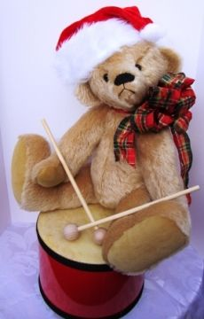 I am delighted to introduce Randy, A Little Drummer Boy, complete with his own 6 inch (15cm) drum. He is approximately 16 inches (40cm) tall and is accessorized with a red Santa hat and plaid Christmas bow.  When not drumming, Randy is content to hang out as a traditional bear with the rest of the hug.  $150.00